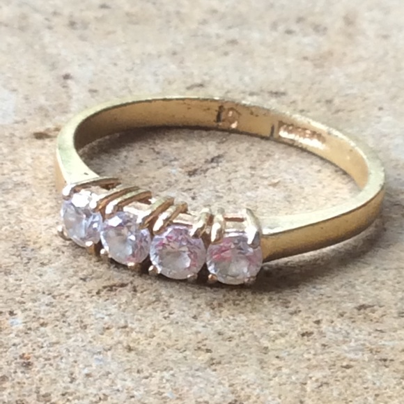 Simple Gold Tone Fashion Ring with 4 Clear Stones